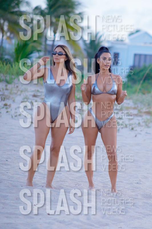 PREMIUM EXCLUSIVE: Kim Kardashian and Larsa Pippen seen wearing matching  silver bikini/swimsuit while on a photoshoot in MIami ...